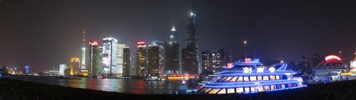 The tall, dark building in the center is the Shanghai Tower, under construction.