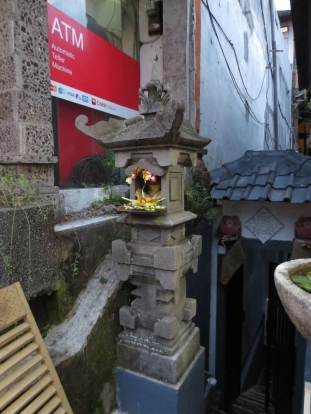These little shrines are all over the place, with offerings of fruit, flowers, etc., left daily.
