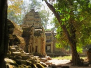 Ta Prohm is the temple made famous in Tomb Raider—it's a striking mix of architecture, crumbling stone, and encroaching forest.
