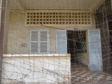 Each large classroom (like the one behind this wire) was converted into many smaller cells.