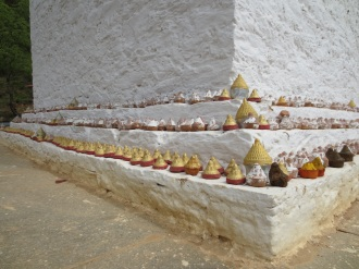 Mini stupas arranged on a larger stupa.