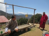 On the left is our guide, Pasang. On the right, the Buddhist monk who made us tea and gave us butter cookies.